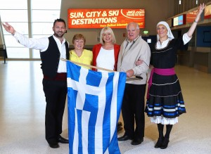 GREECE IS THE WORD...Debbie Abbott (middle), Station Manager Belfast for Jet2.com and Jet2holidays is pictured welcoming Gwen Hillis and Wynne Smith, the first passengers to check-in for today's inaugural flight to Zante. The sold out flight marks the fifth new route to take off from Belfast this year for the leading leisure airline and package holiday specialist with Rome, Prague, Gran Canaria and Verona recent additions now available to Northern Ireland holidaymakers. For more information or to book, visit your local travel agent or click on www.jet2.com or www.jet2holidays.com. Also pictured are Greek entertainers Georgios and Amber Tsoutsas.